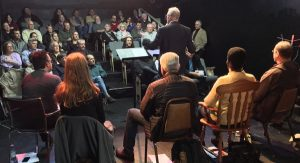 Geoff Miller introduces the script reading event, featuring SAG actors and NWSG screenwriters.