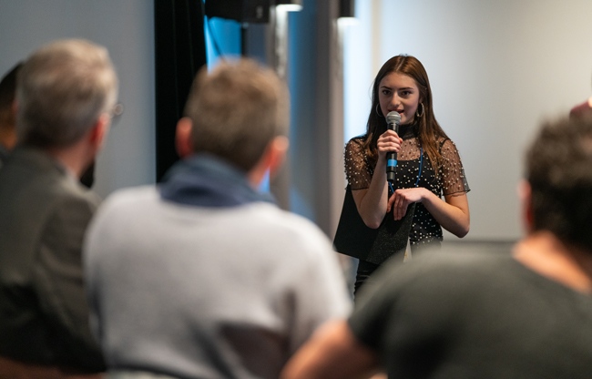 Third-place winner Kara Puerschner delivers her pitch at the 2018 Seattle Film Summit Pitch Panel event.